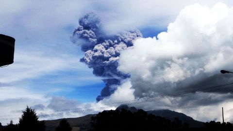 """Cotopaxi, a volcano in Ecuador, sends large gray puffs of ash into the sky on August 14, 2015. Officials <a href=""""http://www.cnn.com/2015/08/15/americas/ecuador-japan-volcanoes/index.html"""">declared a yellow alert</a>, the lowest level."""