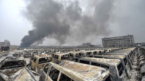 Smoke rises as damaged cars explode on Saturday, August 15.