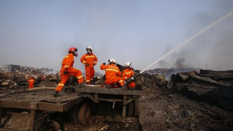 Firefighters work August 15 at the site of the explosions.
