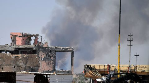 Smoke rises above a damaged building in Ramadi, Iraq, following a coalition airstrike against ISIS positions on Saturday, August 15.