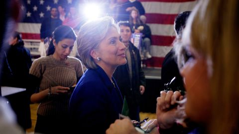 Clinton greets people during a campaign stop at The McConnell Center January 7, 2008 in Dover, New Hampshire, as Abedin stands behind her.