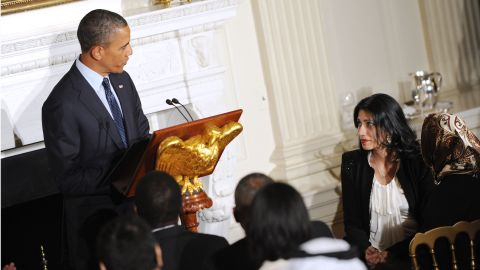 U.S. President Barack Obama acknowledges Abedin at an Iftar dinner celebrating Ramadan in the State Dining Room of the White House August 10, 2012 in Washington.