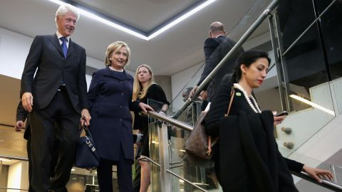 (Left to right) Former U.S. President Bill Clinton, former Secretary of State Hillary Clinton, their daughter Chelsea Clinton and Abedin leave the official memorial service for former South African President Nelson Mandela at FNB Stadium December 10, 2013 in Johannesburg, South Africa.