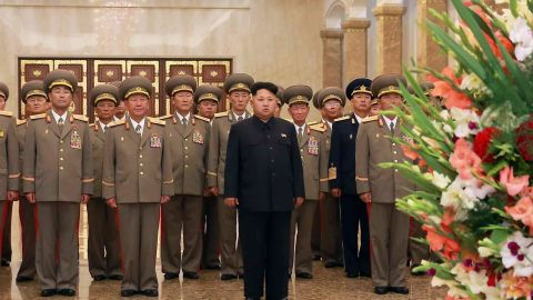 """Caption: This picture taken by North Korea's official Korean Central News Agency (KCNA) on August 15, 2015 shows North Korean leader Kim Jong-Un and Korean People's Army senior officers visiting the Kumsusan Palace of the Sun in Pyongyang for the 70th anniversary of Korea's liberation from Japan. AFP PHOTO / KCNA via KNS REPUBLIC OF KOREA OUT THIS PICTURE WAS MADE AVAILABLE BY A THIRD PARTY. AFP CAN NOT INDEPENDENTLY VERIFY THE AUTHENTICITY, LOCATION, DATE AND CONTENT OF THIS IMAGE. THIS PHOTO IS DISTRIBUTED EXACTLY AS RECEIVED BY AFP. ---EDITORS NOTE--- RESTRICTED TO EDITORIAL USE - MANDATORY CREDIT """"AFP PHOTO / KCNA VIA KNS"""" - NO MARKETING NO ADVERTISING CAMPAIGNS - DISTRIBUTED AS A SERVICE TO CLIENTSKNS/AFP/Getty Images"""