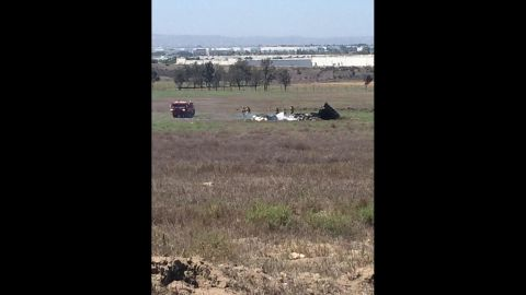 Crews look through the wreckage of two small planes that collided in midair in San Diego.