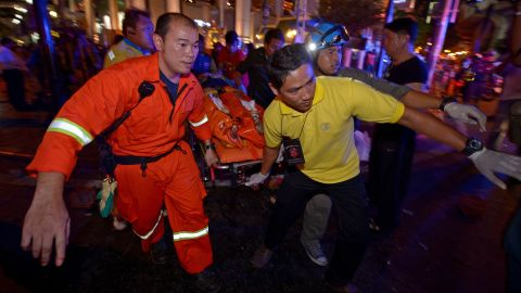 Rescue workers carry an injured person after the bomb exploded on August 17.