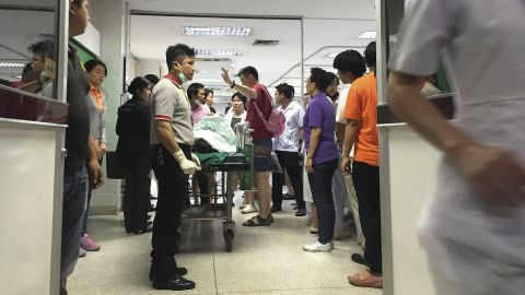 A wounded person lies on a gurney at the Police General Hospital in Bangkok.