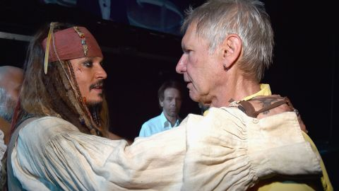 """Is this a bromance in the making? When Captain Jack Sparrow meets Han Solo, it certainly is, at least in our dreams. Johnny Depp (in full Captain Jack regalia) came face to face with Harrison Ford on Saturday, August 15 at Disney's D23 Expo (promoting the next """"Pirates of the Caribbean"""" and the next """"Star Wars,"""" respectively), and the photo quickly went viral. If only we were a fly on the wall ..."""
