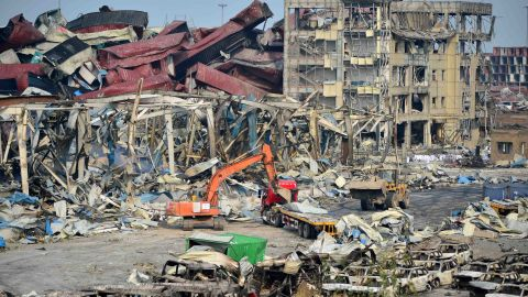 TIANJIN, CHINA - AUGUST 17: (CHINA OUT) Rescuers work at the blast site during the aftermath of the warehouse explosion on August 17, 2015 in Tianjin, China. The death toll has risen to 114 following last Wednesday night's explosion at a warehouse in the Binhai New Area of Tianjin. (Photo by ChinaFotoPress/Getty Images)