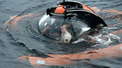 Putin sits in a bathyscaphe as it plunges into the Black Sea along the coast of Sevastopol, Crimea, on Tuesday, August 18. Putin went underwater to see the wreckage of an ancient merchant ship that was found in the end of May.