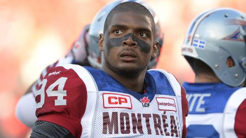 """FILE - In this Aug. 7, 2014, file photo, Montreal Alouettes' Michael Sam and teammates warm up for a Canadian Football League game against the Ottawa Redblacks in Ottawa, Ontario. Sam is stepping away from pro football. Sam, the first openly gay player drafted by the NFL, has told the Alouettes that he is leaving the team. He tweeted Friday, Aug. 14, that """"The last 12 months have been very difficult for me, to the point where I became concerned with my mental health. Because of this I am going to step away from the game at this time."""" (Justin Tang/The Canadian Press via AP, File)"""