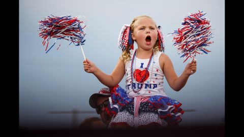A young supporter of Republican presidential candidate Donald Trump cheers at a pep rally in Mobile, Alabama, on August 21, 2015. Trump brought 30,000 supporters -- according to the City of Mobile -- from deep red Alabama to a pep rally in a football stadium, the latest sign that the Republican front-runner has broad, nationwide strength.