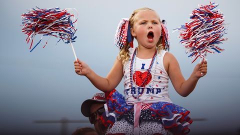 """Laci Lamb, 6, declares Trump """"awesome"""" and cheers at a Trump rally in Mobile, Alabama, on August 21. Her mother, Annie, made her outfit. """"He's the best candidate we've had in a long time,"""" Annie Lamb said."""