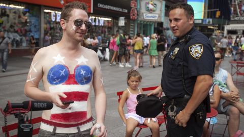 A young man parodies the topless women in Times Square on August 19.