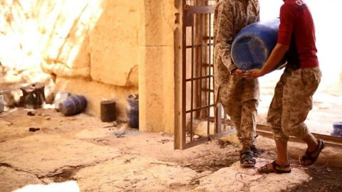 Militants are seen placing explosive devices in the temple, according to the original caption on the photo released by ISIS.