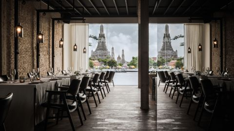 """This Bangkok restaurant's design is from local practice <a href=""""http://www.onion.co.th/"""" target=""""_blank"""" target=""""_blank"""">Onion</a>. Located on the banks of the Chao Phraya river, overlooking the legendary temple of the dawn (Wat Arun), modern interior design is folded into spiritual surroundings. <br /><br />Design by Onion, Photo byWison Tungthunya,W Workspacefrom Let's Go Out Again, Copyright Gestalten 2015"""