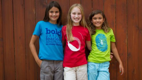 """<a href=""""http://www.girlswillbehq.com/"""" target=""""_blank"""" target=""""_blank"""">Girls Will Be</a> designs clothes with a unique """"in-the-middle"""" fit (not too fitted, but not too boxy) and graphics that break gender stereotypes. The brand comes in bold colors (beyond just pink!) without all the frills."""