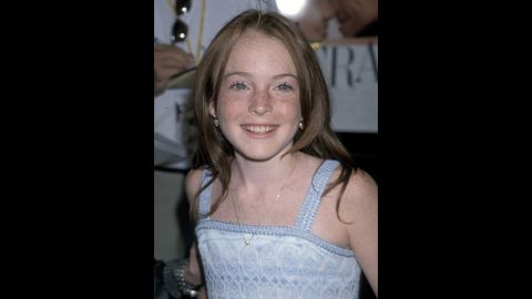 """Lohan showed off her acting prowess at 12 when she played a set of identical twins in the 1998 remake of """"The Parent Trap."""" She went on to star in movies like """"Freaky Friday"""" (2003) and """"Mean Girls"""" (2004), but her tumultuous private life soon interfered with her career."""