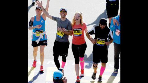 Marathon bombing survivor Adrianne Haslet-Davis crosses the finish line of the 118th Boston Marathon on April 21, 2014 in Boston, Massachusetts.