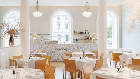 """Located in London's Somerset House, <a href=""""http://springrestaurant.co.uk/"""" target=""""_blank"""" target=""""_blank"""">Spring's</a> light-flooded drawing room is thanks to large arched windows, airy high ceilings. Original cornicing frames the space achieved by architect <a href=""""http://www.stuartforbes.com/"""" target=""""_blank"""" target=""""_blank"""">Stuart Forbes</a>. <br /><br />An atrium garden sits enclosed at the room's center with flora and fauna designs by landscape designer Jinny Blom. Other collaborators on the project include artwork by Emma Peascod and Valeria Nascimento and interior design by Australian Briony Fitzgerald."""