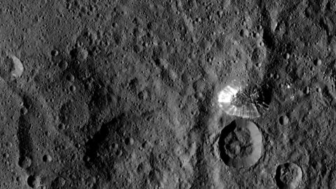 """This tall, <a href=""""http://www.nasa.gov/jpl/dawn-sends-sharper-scenes-from-ceres"""" target=""""_blank"""" target=""""_blank"""">conical mountain on Ceres</a> was photographed from a distance of 915 miles (1,473 kilometers) by NASA's Dawn spacecraft. The mountain, located in the dwarf planet's southern hemisphere, is 4 miles (6.4 kilometers) high. The photo was taken on August 19, 2015."""