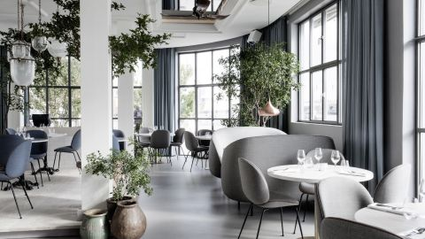 """This pan-Indian restaurant is located within Copenhagen's The Standard hotel. Verandah's design is the work of design duo Stine Gam and Enrico Fratesi. The soft minimalism, punctuated with green planted accents sits in an attractive the original 1930′s building. <br /><br />Design by GamFratesi, Photo byEnok Holsegård and Dinesen/Hviid Photography from <a href=""""http://shop.gestalten.com/out-again.html"""" target=""""_blank"""" target=""""_blank"""">Let's Go Out Again</a>, Copyright Gestalten 2015"""