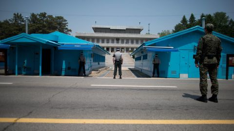 Sout Korean soldiers face the North Korean side at the truce village of Panmunjom in the DMZ.