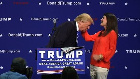 Trump asks an audience member to inspect his hair to verify it's real during an event in Greenville, South Carolina, on August 27.