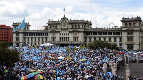 People demonstrate in demand of Guatemalan President Otto Perez to step down over a corruption scandal, in front of the National Palace Guatemala City on August 27, 2015. Perez suffered a double setback Wednesday, after the country's top prosecutor called for his resignation and his ex-vice president was maintained in jail for tax fraud. AFP PHOTO / JOHAN ORDONEZJOHAN ORDONEZ/AFP/Getty Images