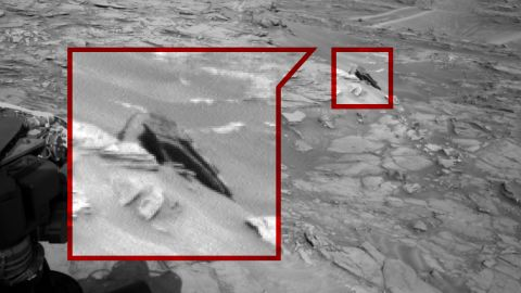 The Star Destroyer: UFO buffs claim this pic shows a Star Wars-like spaceship that crash landed on the red planet.