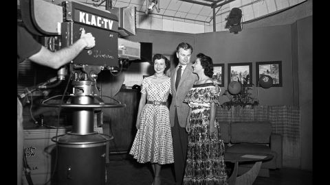 """Betty White, left, actor Eddie Albert, and an unidentified woman pose in front of the a KLAC-TV camera during a broadcast of the talk show, """"Hollywood on Television,"""" in 1952. The show was """"like going to television college,"""" she said."""