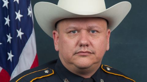 A man gunned Darren H. Goforth, 47, down as he returned to his patrol car after pumping gas