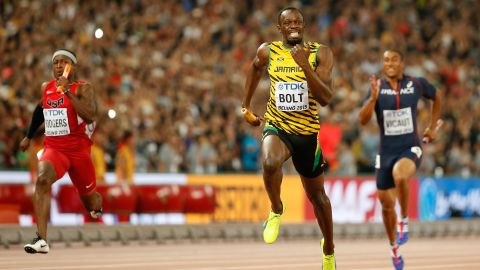 Usain Bolt of Jamaica crosses the finish line to win gold in the men's 4x100 metres relay final ahead of Mike Rodgers of the United States at the 2015 World Athletics Championships in Beijing.