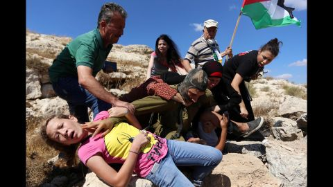 """The Israeli army defended its actions, saying that people in the crowd had thrown rocks at the soldiers. """"The forces decided to detain one of the Palestinians identified hurling rocks,"""" an Israeli army spokeswoman told CNN. The army said the commander at the scene halted the arrest to avoid an escalation of the situation."""