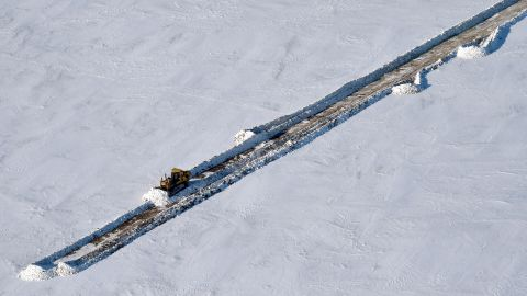 A picture taken on April 16 shows a bulldozer clearing a snow-covered road at the village of Sabetta in the Kara Sea shore line on the Yamal Peninsula in the Arctic circle, some 2450 km of Moscow.