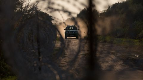SZEGED, HUNGARY - AUGUST 31: Hungarian police patrol the border from Serbia into Hungary close to the village of Roszke on August 31, 2015 near Szeged, Hungary. According to the Hungarian authorities a record number of migrants from many parts of the Middle East, Africa and Asia crossed the border from Serbia earlier this week, said to be due in part to the erection of a new fence that is due to be completed at the end of this month. Since the beginning of 2015 the number of migrants using the so-called Balkans route has exploded with migrants arriving in Greece from Turkey and then travelling on through Macedonia and Serbia before entering the EU via Hungary. The massive increase, said to be the largest migration of people since World War II, led Hungarian Prime Minister Victor Orban to order Hungary's army to build a steel and barbed wire security barrier along its entire border with Serbia, after more than 100,000 asylum seekers from a variety of countries and war zones entered the country so far this year. (Photo by Matt Cardy/Getty Images)