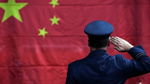 LONDON, ENGLAND - SEPTEMBER 08:  A military honour guard raises the flag of China during a table tennis medal ceremony on day 10 of the London 2012 Paralympic Games at ExCel on September 8, 2012 in London, England.  (Photo by Matthew Lloyd/Getty Images)