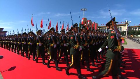 Chinese soldiers march past the Great Hall of the People at Tiananmen Square on September 3, 2015 in Beijing, China.