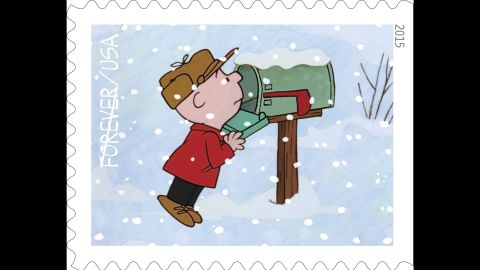 Charlie Brown searches in vain in his mailbox for a Christmas card.