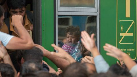Migrants board trains in Keleti station in Budapest after it was reopened on September 3, 2015.