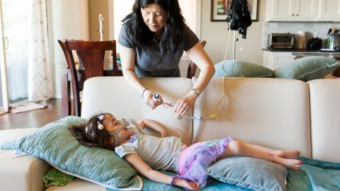 Initially, Julianna's parents arranged for braces on her ankles and feet in the hopes she might walk one day. Eventually, they understood that day would never come.