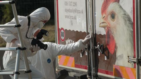 """Investigators in Burgenland, Austria, inspect an abandoned truck that contained the bodies of refugees who died of suffocation in August 2015. The 71 victims -- most likely <a href=""""http://www.cnn.com/2015/08/28/europe/migrant-crisis/index.html"""" target=""""_blank"""">fleeing war-ravaged Syria</a> -- were 60 men, eight women and three children."""