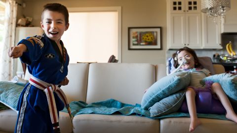 Julianna showed no envy toward Alex, who raced up and down the hallway and did martial arts around her.