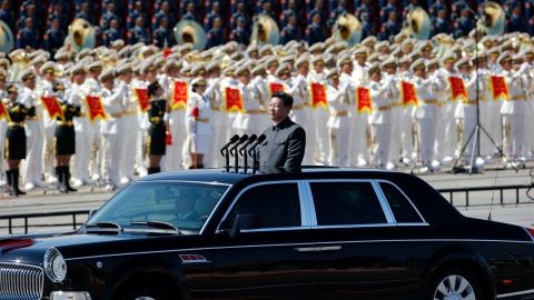 Chinese President Xi Jinping stands in a sedan to address the People's Liberation Army on September 3.