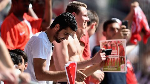 Bayern isn't the only German club helping migrants. Here refugees, invited by  Mainz 05, attend a Bundesliga match against Hannover 96 at Coface Arena in August.