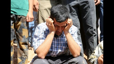 Abdullah Kurdi, the boys' father and widower of Rehen, mourns during the funeral in Kobani on September 4, 2015.
