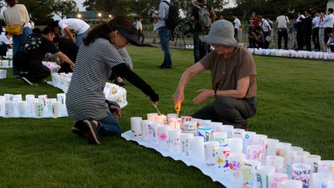 This picture taken on Friday, September 4, 2015, shows people lighting candles to celebrate at Naraha town in Fukushima as the Japanese government lifts an evacuation order to Naraha near the crippled nuclear plant, after a clean-up program has lowered radiation levels in the area. Among communities where the entire population was forced to evacuate after the nuclear crisis started in March 2011, Naraha is the first town to allow all of its residents to return home permanently.