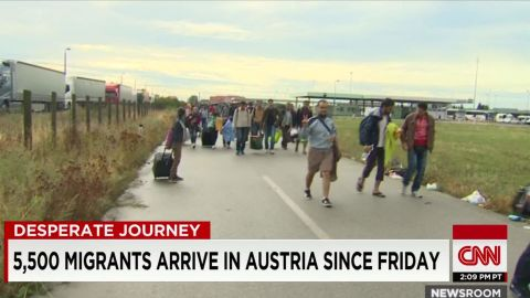 migrants getting food water tickets nr pleitgen pkg_00011514.jpg