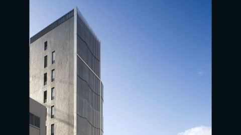 """The rippling lines of the building's facade are based on the score of a Gregorian chant. Project architect Christopher Khoo of Eco.id Architects, says the inspiration behind the building's facade was church instruments. """"We wanted to use a simple material, in this case, lightweight aluminum. It resembles wind chimes or organ pipes. The aluminum tubes were used to give the building a modern look."""" <br />"""