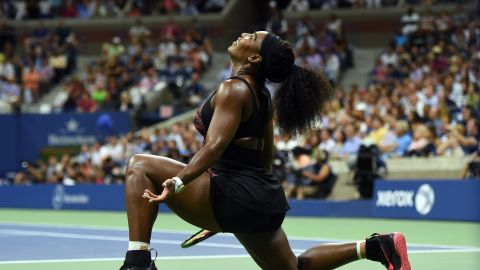Serena Williams of the US reacts as she plays against her sister Venus Williams during their 2015 US Open Women's singles quarterfinals match at the USTA Billie Jean King National Tennis Center in New York on September 8, 2015. AFP PHOTO/JEWEL SAMAD        (Photo credit should read JEWEL SAMAD/AFP/Getty Images)